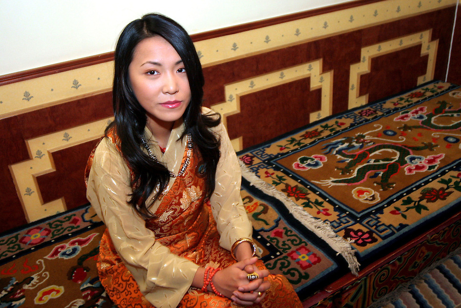 """BEIJING, CHINA - November 6, 2005 - The last Panchen Lama's daughter, Yabshi Pan Rinzinwangmo at her home in Beijing. Yabshi Pan Rinzinwangmo is familiarly known to her friends as """"Renji"""" but to many others she is known as the """"Princess of Tibet"""". Her father was the 10th Panchen Lama, a Buddhist monk ranking close to the Dalai Lama in Tibet's spiritual leadership, who died in 1989. Her mother, Li Jie, is a former doctor in China's People's Liberation Army and granddaughter of a famous general in China's civil war. After 10 years studying in the United States, at high school in Los Angeles and then political science at the American University in Washington, Renji has just returned to China for further studies at the elite Tsinghua University to prepare for what she sees as her future role as a """"unifier""""."""