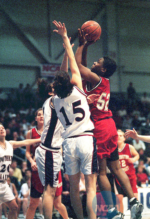 18 MAR 2000:  Forward Tasha Rodgers (52) of Washington University puts a shot up over University of Southern Maine forward Jessica Hopkins (15) during the Division 3 Women's Basketball Championship held at the O'Neill Center on the Western Connecticut State University campus in Danbury, CT.  Washington University defeated the University of Southern Maine 79-33 for the championship title.  Jeff Holt/NCAA Photos