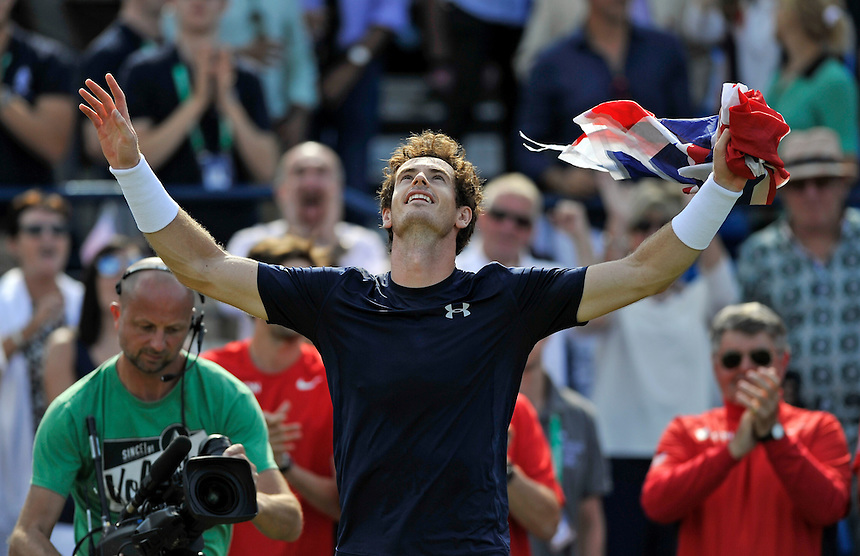 Andy Murray celebrates victory over Gilles Simon - Andy MURRAY def Gilles SIMON 4-6, 7-6, 6-3, 6-0<br /> <br /> <br /> Photographer Ashley Western/CameraSport<br /> <br /> International Tennis - 2015 Davis Cup by BNP PARIBAS - World Group Quarterfinals - Great Britain v France - Day 3 - Sunday 19th July 2015 - Queens Club - London<br /> <br /> &copy; CameraSport - 43 Linden Ave. Countesthorpe. Leicester. England. LE8 5PG - Tel: +44 (0) 116 277 4147 - admin@camerasport.com - www.camerasport.com.