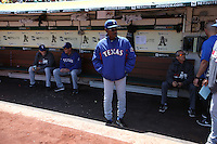 OAKLAND, CA - APRIL 23:  Manager Ron Washington #38 of the Texas Rangers stands in front of the dugout before the game against the Oakland Athletics at O.co Coliseum on Wednesday, April 23, 2014 in Oakland, California. Photo by Brad Mangin