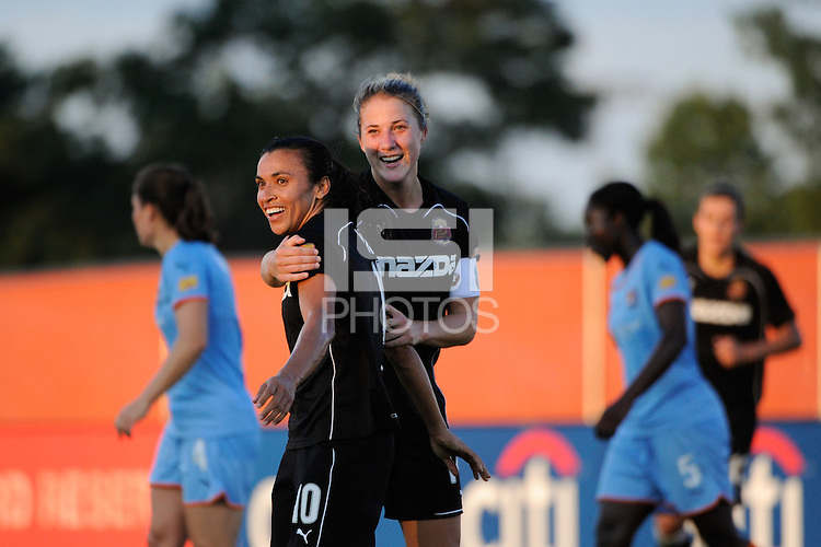 Marta (10) of the Western New York Flash celebrates scoring with Becky Edwards (14). The Western New York Flash defeated Sky Blue FC 4-1 during a Women's Professional Soccer (WPS) match at Yurcak Field in Piscataway, NJ, on July 30, 2011.