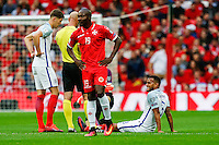 Ryan Bertrand (Southampton) of England sits injured on the floor before leaving the field during the FIFA World Cup qualifying match between England and Malta at Wembley Stadium, London, England on 8 October 2016. Photo by David Horn / PRiME Media Images.