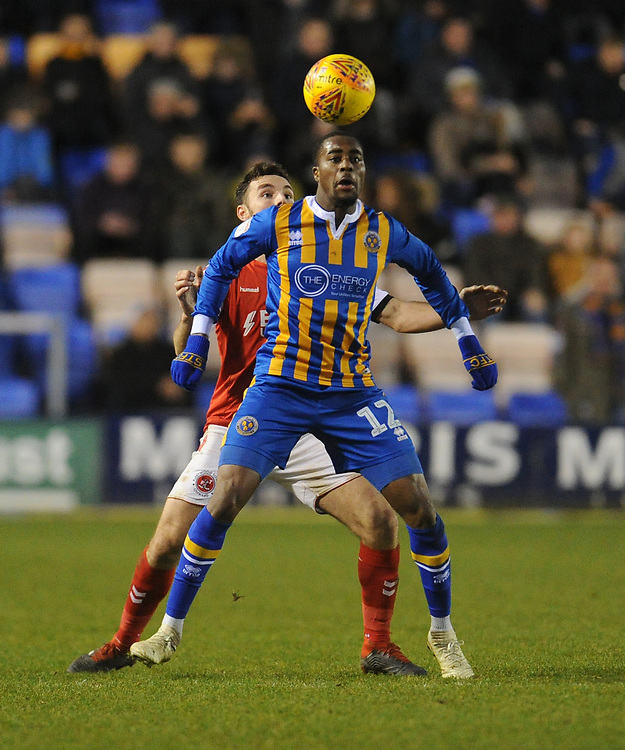 Shrewsbury Town's Fejiri Okenabirhie under pressure from Fleetwood Town's Lewie Coyle<br /> <br /> Photographer Kevin Barnes/CameraSport<br /> <br /> The EFL Sky Bet League One - Shrewsbury Town v Fleetwood Town - Tuesday 1st January 2019 - New Meadow - Shrewsbury<br /> <br /> World Copyright © 2019 CameraSport. All rights reserved. 43 Linden Ave. Countesthorpe. Leicester. England. LE8 5PG - Tel: +44 (0) 116 277 4147 - admin@camerasport.com - www.camerasport.com
