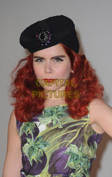 Paloma Faith.The Brit Awards 2012 arrivals, O2 Arena, North Greenwich,  London, England 21st February 2012 .Brits headshot portrait black hat brooch purple sleeveless green floral print.CAP/WIZ.© Wizard/Capital Pictures.
