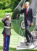 United States President Barack Obama salutes the Marine Guard as he arrives on the South Lawn of the White House in Washington, D.C. after traveling to Atlanta, Georgia to speak at the national convention of Disabled American Veterans on Monday, August 3, 2010. .Credit: Ron Sachs / Pool via CNP