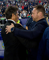 CARSON, CA - MARCH 07: Guillermo Barros head coach of the Los Angeles Galaxy and Marc Dos Santos head coach of the Vancouver Whitecaps exchange pleasantries with one another before the start of the match during a game between Vancouver Whitecaps and Los Angeles Galaxy at Dignity Health Sports Park on March 07, 2020 in Carson, California.