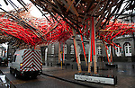 """Belgium, Mons - December 17, 2014 -- European Capital of Culture in 2015 (together with the Czech city of Pilsen) themed """"Where technology meets culture""""; here, the largest installation of Mons 2015, """" The Passenger"""" - a forest of matches created by artist Arne Quinze, at the palace of Justice, rue Nimy -- Photo © HorstWagner.eu"""