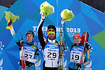 From left at the podium (UKR) Vitaliy Kilchytskyy, Milanko Petrovic (SRB) and UKR Dmytro Pidruchyi (UKR) competes during the 20 km Individual Biathlon race as part of the Winter Universiade Trentino 2013 on 15/12/2013 in Lago Di Tesero, Italy.<br /> <br /> &copy; Pierre Teyssot - www.pierreteyssot.com