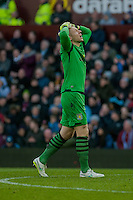 BIRMINGHAM, ENGLAND - MARCH 21:   Brad Guzan of Aston Villa  holds his head in his hands during the Barclays Premier League match between Aston Villa and Swansea City at Villa Park on March 21, 2015 in Birmingham, England. (Photo by Athena Pictures/Getty Images)