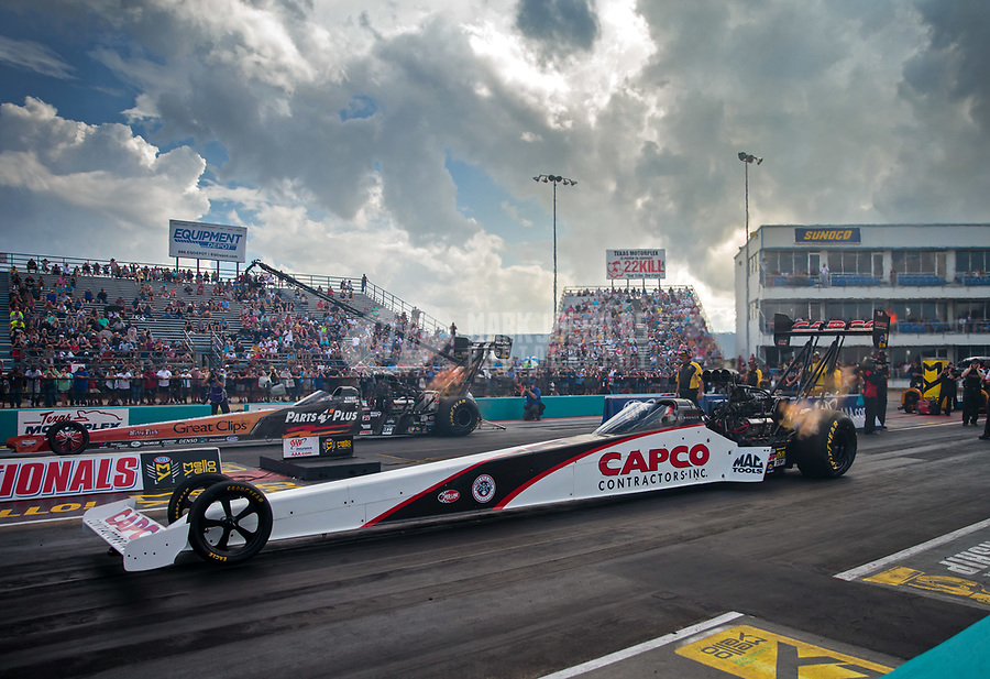Oct 6, 2018; Ennis, TX, USA; NHRA top fuel driver Steve Torrence (near) races alongside Clay Millican during qualifying for the Fall Nationals at the Texas Motorplex. Mandatory Credit: Mark J. Rebilas-USA TODAY Sports