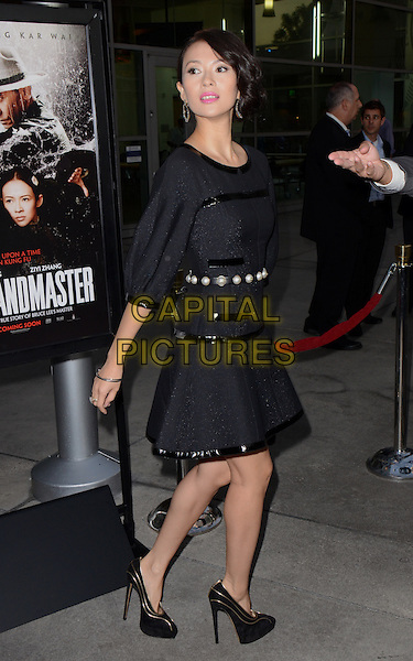 Ziyi Zhang<br /> Screening of &quot;The Grandmaster&quot;, Hollywood, California, USA.<br /> August 22nd, 2013<br /> full  length black dress side looking over shoulder pearl belt waist <br /> CAP/ADM/TW<br /> &copy;Tonya Wise/AdMedia/Capital Pictures