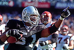 Oakland Raiders vs. Cincinnati Bengals at Oakland Alameda County Coliseum Sunday, October 25, 1998.  Raiders beat Bengals 27-10.  Oakland Raiders defensive end Lance Johnstone (51).