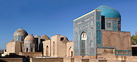 "Panoramic view of Mausoleums of the middle group, Shah-I Zinda Complex, Samarkand, Uzbekistan, pictured on July 19, 2010, in the early morning. The Shah-i-Zinda Complex is a necropolis of mausoleums whose legendary origin dates back to 676 when Kussam-ibn-Abbas arrived to convert the locals to Islam. So successful was he that he was assassinated whilst at prayer. His grave remains the centre of the sacred site which grew over many centuries, especially the 14th and 15th, into an architecturally stunning  example of ceramic art. From right to left: ""Nameless 1"" Mausoleum, 1380s, created by Usto Alim Nesefi, the mausoleum is decorated  with relief painted majolica; the portal decorations are notable for the symbol of ""octagonal stars""; to its left are 4 unknown Mausoleums; then another Mausoleum built in the 1380s, and on the extreme left, an octagonal pavilion with a high dome and lancet arches, built under Ulugh Beg. Samarkand, a city on the Silk Road, founded as Afrosiab in the 7th century BC, is a meeting point for the world's cultures. Its most important development was in the Timurid period, 14th to 15th centuries. Picture by Manuel Cohen."