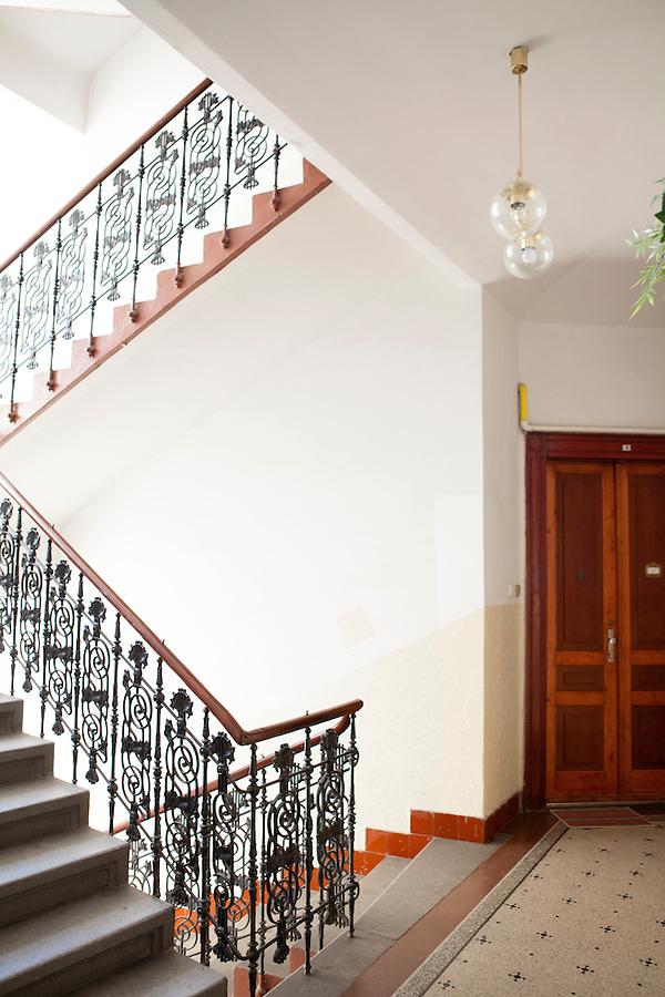 Apartment building interior with an elegant wrought-iron staircase railing, Prague, Czech Republic, Europe