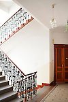 Apartment building interior with an elegant wrought-iron staircase railing, Prague, Czech Republic, Europe