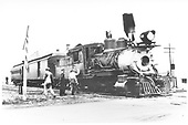 3/4 engineer's-side view of C&amp;S #6 with a two-car passenger train stopped at a grade crossing while the crew attends to something on the engine's cab.<br /> C&amp;S  Como, CO