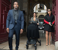 Kim Kardashian and Kanye West leave their Paris apartment with baby and Kris Jenner  - France