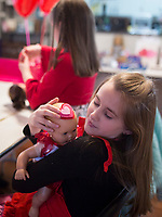 NWA Democrat-Gazette/CHARLIE KAIJO Kelsey Fisher, 9, of Bentonville adjusts a headband she made for her doll, Sunday, February 11, 2018 at the Croppin' Train Hobby House in Bentonville. <br /><br />Girls brought their 18&quot; dolls to a Girls &amp; Dolls Valentine Party. The girls enjoyed a light luncheon, then some crafting for themselves and their dolls.<br /><br />Typically adult women will come to Hobby House and stay for a weekend retreat and scrapbook. The house provides beds for the women interested in staying for the weekend. They provide women a chance to get together and fellowship.