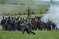 NWA Democrat-Gazette/ANDY SHUPE<br /> A wounded soldier is helped from the battlefield Saturday, Sept. 26, 2015, during a re-enactment of the Civil War Battle of Pea Ridge in Pea Ridge. Visit nwadg.com/photos to see more photos from the weekend.