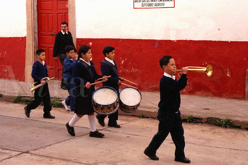 School children practice for independence day parade, playing drums and trumpet. Patzcuaro Michoacan Mexico.