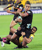 Ngani Laumape tackles Chiefs winger Sean Wainui during the Super Rugby match between the Hurricanes and Chiefs at Westpac Stadium in Wellington, New Zealand on Friday, 13 April 2018. Photo: Dave Lintott / lintottphoto.co.nz