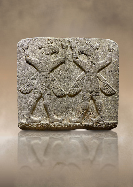 "Hittite relief sculpted orthostat stone panel of Herald's Wall Basalt, Karkamıs, (Kargamıs), Carchemish (Karkemish), 900-700 B.C. Bird-headed, winged figures of human body. Anatolian Civilisations Museum, Ankara, Turkey.<br /> <br /> These figures are called as ""Winged Griffin Demons"". Embossing is constructed symmetrically. Their hands are on their heads. It is assumed that they carry the heavens. <br /> <br /> Against a brown art background."