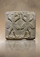 Hittite relief sculpted orthostat stone panel of Herald's Wall Basalt, Karkamıs, (Kargamıs), Carchemish (Karkemish), 900-700 B.C. Bird-headed, winged figures of human body. Anatolian Civilisations Museum, Ankara, Turkey.<br /> <br /> These figures are called as &quot;Winged Griffin Demons&quot;. Embossing is constructed symmetrically. Their hands are on their heads. It is assumed that they carry the heavens. <br /> <br /> Against a brown art background.