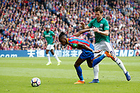Wilfried Zaha of Crystal Palace is pushed by Grzegorz Krychowiak of West Brom during the EPL - Premier League match between Crystal Palace and West Bromwich Albion at Selhurst Park, London, England on 13 May 2018. Photo by Carlton Myrie / PRiME Media Images.