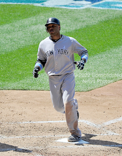 New York Yankees second baseman Robinson Cano (24) touches home after connecting for a seventh inning home run against the Washington Nationals at Nationals Park in Washington, D.C. on Sunday, June 17, 2012.  The Yankees won the game 4 - 1..Credit: Ron Sachs / CNP.(RESTRICTION: NO New York or New Jersey Newspapers or newspapers within a 75 mile radius of New York City)