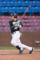Tyler Bortnick #16 of the Coastal Carolina Chanticleers follows through on his swing versus the Wake Forest Demon Deacons at Wake Forest Baseball Park April 8, 2009 in Winston-Salem, North Carolina. (Photo by Brian Westerholt / Four Seam Images)