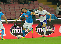 Gonzalo Higuain challanges Lorenzo de Silvestri  during the Italian Serie A soccer match between   SSC Napoli and UC Sampdoria at San Paolo  Stadium in Naples ,April 26 , 2015