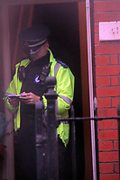 Pictured: A police officer at the house of Joshua Davies in Aberkenfig south Wales. Tuesday 26 October 2010<br />