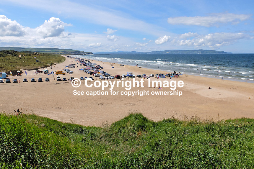 Portstewart Strand, Portstewart, Co Londonderry, N Ireland, UK, sunny day, blue sky, white clouds, July, 2015, 201507251197<br /> <br /> Copyright Image from Victor Patterson,<br /> 54 Dorchester Park, Belfast, UK, BT9 6RJ<br /> <br /> t1: +44 28 90661296<br /> t2: +44 28 90022446<br /> m: +44 7802 353836<br /> <br /> e1: victorpatterson@me.com<br /> e2: victorpatterson@gmail.com<br /> <br /> For my Terms and Conditions of Use go to<br /> www.victorpatterson.com
