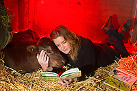 Clarence the Calf listens to Dr. Seuss at NWESC