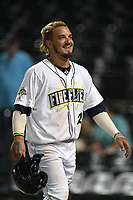 Right fielder Jay Jabs (21) of the Columbia Fireflies returns to the dugout after scoring a run during a game against the Charleston RiverDogs on Tuesday, August 28, 2018, at Spirit Communications Park in Columbia, South Carolina. (Tom Priddy/Four Seam Images)