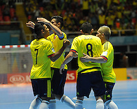 CALI -COLOMBIA-16-09-2016: Jhonatan Toro (Izq) jugador de Colombia celebra después de anotar un gol a Panama durante partido del grupo A de la Copa Mundial de Futsal de la FIFA Colombia 2016 jugado en el Coliseo del Pueblo en Cali, Colombia. / Jhonatan Toro (L) player of Colombia celebrates after scoring a goal to Panama during match of the group A of the FIFA Futsal World Cup Colombia 2016 played at Metropolitan Coliseo del Pueblo in Cali, Colombia. Photo: VizzorImage/ NR / Cont
