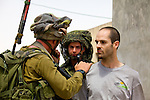 IDF soldiers arrest a peace activist after entering the village of An Nabi Salih near Ramallah on 11/06/2010. The soldiers entered the village after being stoned by Palestinian youths following the peaceful end to a demonstration by the Palestinian residents of An Nabi Salih against the planned demolition of village houses by the Israeli military.