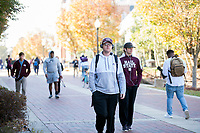 Students walking on Old Main Plaza with fall leaves.<br />  (photo by Megan Bean / &copy; Mississippi State University)