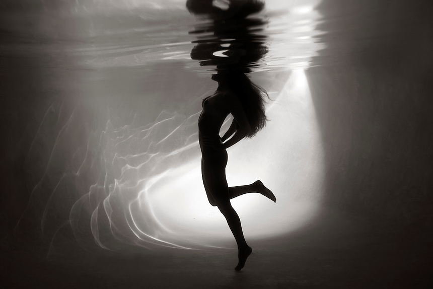 A female underwater fashion model.