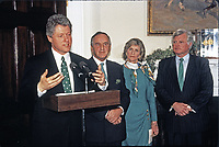 United States President Bill Clinton makes remarks as he participates in the annual presentation of a bowl of shamrocks honoring St. Patrick's Day with Taoiseach (Prime Minister) Albert Reynolds of Ireland in the Roosevelt Room of the White House in Washington, DC on March 17, 1993. During his remarks, President Clinton announced he was naming Jean Kennedy Smith as US Ambassador to Ireland.  From left to right: President Clinton, Prime Minister Reynolds, Jean Kennedy Smith, and US Senator Ted Kennedy (Democrat of Massachusetts).<br /> Credit: Martin H. Simon / Pool via CNP/AdMedia