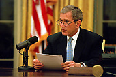 United States President George W. Bush records his weekly radio address from his desk in the Oval Office of the White House in Washington, DC on Friday, February 16, 2001.<br /> Mandatory Credit: Paul Morse / White House via CNP