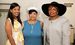 WATERBURY, CT-060317JS07-  Jennifer Minnis, Deanna Davis and Lottie Johnson-Antrum (cq) at the annual Greater Waterbury Chapter of the National Congress of Black Women, Inc.'s Hat and Tea Scholarship Luncheon Saturday at the Mt. Olive A.M.E. Zion Church in Waterbury.  <br /> Jim Shannon Republican-American