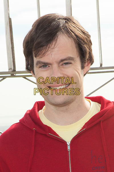Actor/Comedian Bill Hader voice of Flint Lockwood from the upcoming Sony pictures animation film 'Cloudy With A Chance of Meatballs 2' visits the Empire State Building, New York City, New York, USA.<br /> September 25th, 2013 <br /> headshot portrait red top hoody hoodie hooded<br /> CAP/MPC/COR<br /> &copy;Corredor99/ MediaPunch/Capital Pictures