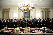 United States President Donald J. Trump speaks behind a table full of McDonald's hamburgers, Chick fil-a sandwiches and some other fast food as he welcomes the 2018 Division I FCS National Champions: The North Dakota State Bison in the Diplomatic Room of the White House on March 4, 2019 in Washington, DC. <br /> Credit: Oliver Contreras / Pool via CNP