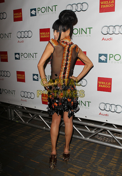 Bai Ling<br /> &ldquo;Voices on Point&rdquo; iConcert and dinner benefiting Point Foundation Held at The Hyatt Regency Century Plaza, Century City, California, USA, 7th September 2013.<br /> full length black orange dress beaded high neck mesh sheer bun hair up hands on hips feathers back rear behind over shoulder <br /> CAP/ADM/KB<br /> &copy;Kevan Brooks/AdMedia/Capital Pictures