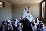 "15 June 2013, Dari Cha Noor School, Qargha, Kabul Province,  Afghanistan. Ten year old Rahnoor at the Dari Cha Noor (""Window to Knowledge"") School. Her family fled Wardak Province to escape the violence of the war which included Rahnoor's school being burnt to the ground by the Taliban. The school has begun to formulate plans to improve and expand under the  Education Quality Improvement Program (EQUIP). Currently they have only organised the shura council but already they have enrolled another 75 students in the last three months. The school will benefit from the EQUIP whose objective is to increase access to quality basic education, especially for girls. School grants and teacher training programs are strengthened by support from communities and private providers.  Picture by Graham Crouch/World Bank"