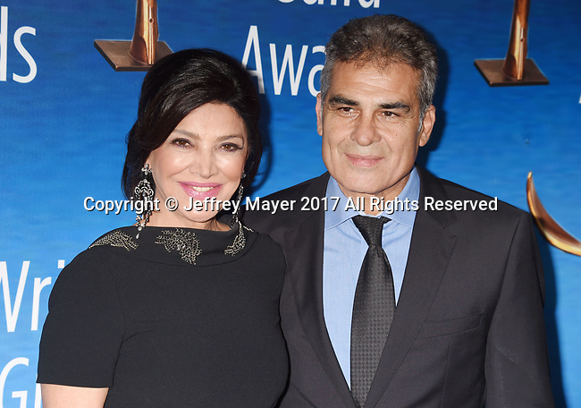BEVERLY HILLS, CA - FEBRUARY 19: Actors Shohreh Aghdashloo (L) and Houshang Touzie attend the 2017 Writers Guild Awards L.A. Ceremony at The Beverly Hilton Hotel on February 19, 2017 in Beverly Hills, California.
