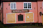 Closed down boarded up village pub, Horse and Groom, Melton, Suffolk, England
