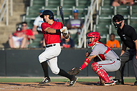 J.J. Franco (1) of the Kannapolis Intimidators follows through on a 2-run double down the third base line in the bottom of the 6th inning against the Hagerstown Suns at Kannapolis Intimidators Stadium on July 9, 2017 in Kannapolis, North Carolina.  The Intimidators defeated the Suns 3-2 in game two of a double-header.  (Brian Westerholt/Four Seam Images)