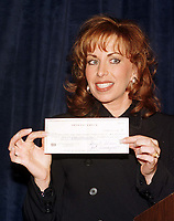 ***FILE PHOTO*** Bill Clinton Has Not Apologized To Monica Lewinsky And Claims Did The Right Thing Staying In Office.<br /> <br /> Paula Jones shows off the one million dollar check given to her by Abe Hirschfeld in an attempt to settle her sexual harassment lawsuit against United States President Bill Clinton at the Mayflower Hotel in Washington, DC on 31 October, 1998.<br /> CAP/MPI/RS<br /> &copy;RS/MPI/Capital Pictures